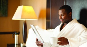 hotel- dude reading paper